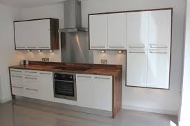 White Gloss Kitchen White Gloss Kitchen With Wood Wrap Around Kitchen Design