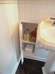 built in bathroom wall storage shelves are storing shampoo conditioner perfume bar