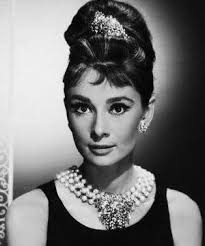 ap photo file actress audrey hepburn with her hair up in a beehive poses as holly golightly in the 1961 breakfast at tiffany s