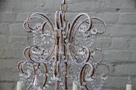 pair of elegant italian gilt metal and crystal chandeliers 7 500 each