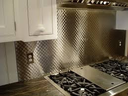Stainless Steel Backsplash with Small Quilt Pattern - Brooks Custom & tiny quilted pattern on a stainless steel backsplash Adamdwight.com