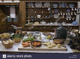 kitchen table with food. Food Being Prepared On The Kitchen Table At Lanhydrock, Cornwall. Dresser Behind Houses China And Copper Utensils With