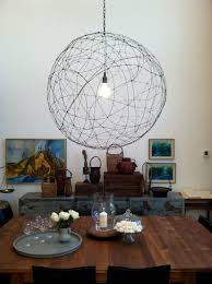 large orb chandelier. This Unique Chandelier Caught Our Attention As Soon We Laid Eyes On It! The Large Orb Is Constructed By First Arranging Circles Of Thick Wire Into A