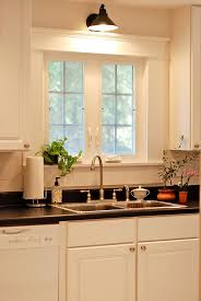 Sconce Over The Kitchen Sink This Window Has Gorgeous Trim Too  Pinterest