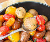 baby potatoes and sweet peppers in tomato dill butter