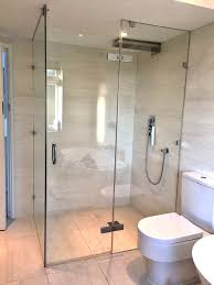 large frameless glass wetroom shower enclosure with floor to ceiling inline and side panels with glass