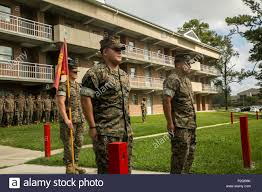 sgt samuel poore and sgt julio quinonez stand at attention waiting to receive their navy and marine corps achievement medal at c lejeune n c sept