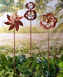 enliven your outdoor space with a set of 3 classic garden wind spinners just push each stake into the ground and enjoy the mesmerizing movement of this