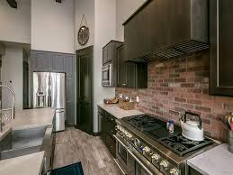 Traditional kitchen with red brick backsplash
