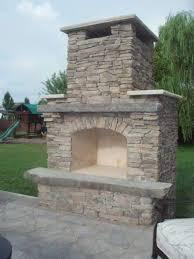 millenium stone works custom backyard fireplace