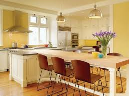 Picture of Yellow Combo Kitchen Design with White Island and Dining Table