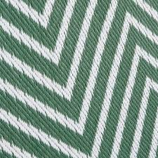green outdoor carpet with white graphic motifs 180x270