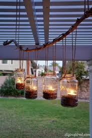 this easy diy mason jar chandelier project is simple and uses supplies you probably have around