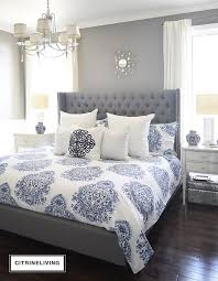 bright cool blue patterns add a lush touch to this sleek grey bedframe