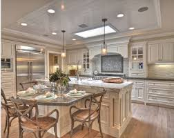 10 Beautiful Kitchen Island Table Designs Housely Inside Kitchen Island  Tables Decorating ...