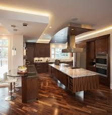 easy kitchen remodeling ideas with incredible lighting above over cabinet displays walnut hardwood flooring and mini bar using glass top accent counter