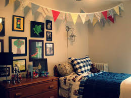 cool dorm room decorations guys. idea for guys dorm room present wall sconce lamp over plaid accent pillow and hanging banner cool decorations e
