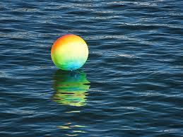 Beach ball in ocean Water Ball Photograph Rainbow Beachball Bobbing On The Ocean By Susie Peek Fine Art America Rainbow Beachball Bobbing On The Ocean Photograph By Susie Peek