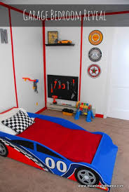 A race car garage room, what else could a little boy want? When I told my  husband my boys' room design ideas, he was immediately on board.