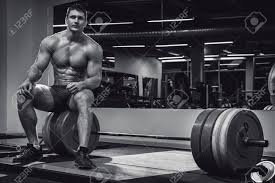 muscular man in gym after his deadlift workout stock photo 56636002