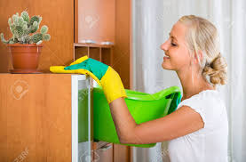 dusting furniture. Happy Young Blonde Woman In Rubber Gloves Dusting Furniture At Home Stock Photo - 47015290 E
