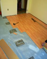 Floating Floor In Kitchen How To Install A Laminate Floor How Tos Diy