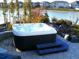 outside jacuzzi outdoor surrounded jacuzzi tub