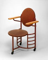 frank lloyd wright designed chair for the johnson wax headquarters manufactured by steelcase inc
