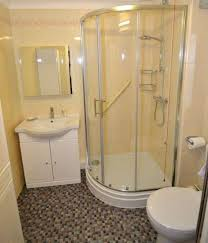 bathroom ideas corner shower design: good basement bathroom ideas with corner shower stall and mosaic floor tiles have basement shower ideas