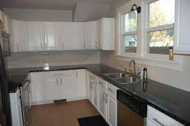 Rhpinterestcom Grey Tile Backsplash White Cabinets Black Countertops