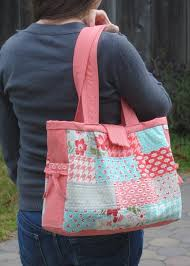 7 Patchwork and Quilted Bag Designs to Try & Pink and Pastel Quilted Bag on Woman's Shoulder Adamdwight.com