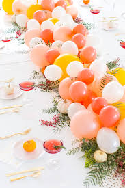 diy balloon friendsgiving table centerpiece a cocktail recipe too