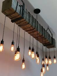 reclaimed hand hewn barn beam light fixture with wrapped lights and black metal hanging brackets we will customize the length of wire and black chain to
