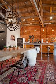 quirky industrial boho kitchen and dining e in mulu s creative vine collective den love the fur persian rug pot plants bare bulbs