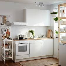 Small White Kitchen A Small White Kitchen Consisting Of A Complete Base Cabinet With