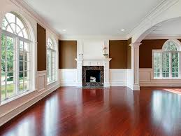 Living Room In New Construction Home With Cherry Wood Flooring Pictures