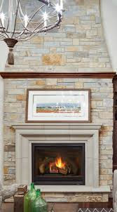 an elegant and imposing cast concrete surround and stunning stone wall with erscotch tones adds to the traditional look of this great room fireplace