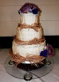 Decorating With Raffia Rustic Wedding Cake With Raffia Top Amp Bottom Tiers Are Vanilla