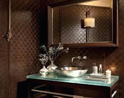 small powder room lighting above mirror