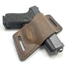 that s my glock 19 in the versacarry owb holster it fits perfectly because the holster conforms to the nuances of the s shape