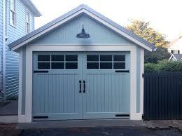 blue garage doors before after image of updated garage door in pale blue with white trim blue garage doors
