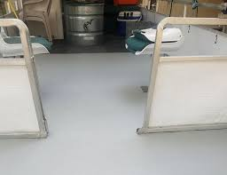 this pontoon boat has a painted floor instead of carpet