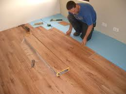 image of laying laminate flooring over tile
