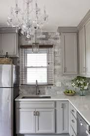 black quartz countertops with white and gray marble chevron tiles for a stunning look feasbyandbleeks com