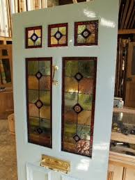 3 over 2 panel front door painted and incorporating stained glass panels with brilliant cut inserts