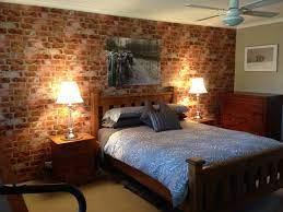 brick wallpaper accent wall in bedroom