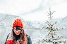 lia in red lipstick on a snowy day in hallstatt austria