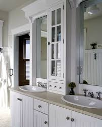 Bathroom vanity design Corner Basic Dualsink Vanity Is Upgraded With New Marble Top And Slender Glassfront Cabinet At Counter Level Between The Two Sinks Lowes Decorating Bath Vanities Traditional Home