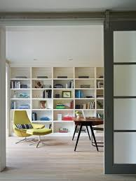 contemporary home office sliding barn. Contemporary Barn Doors Home Office With Green Chair Ottoman Built In Shelves Sliding