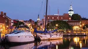 illuminated by the lights of annapolis along main street modern family cruisers and traditional workboats share a rare quiet moment on the city dock